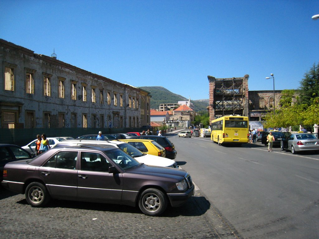 Parking and destroyed buildings.